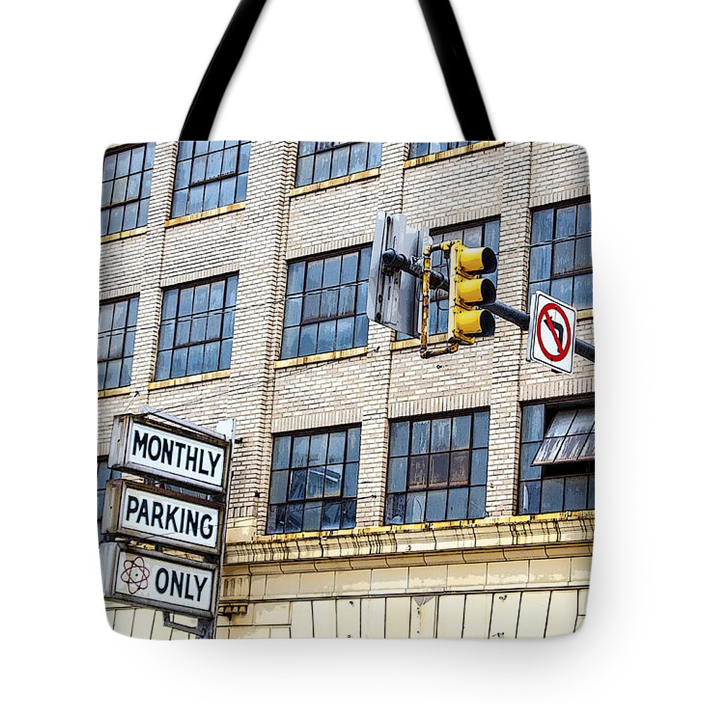 Information Medium Tote Bag featuring the photograph Urban Garage Monthly Parking Only by Janice Pariza