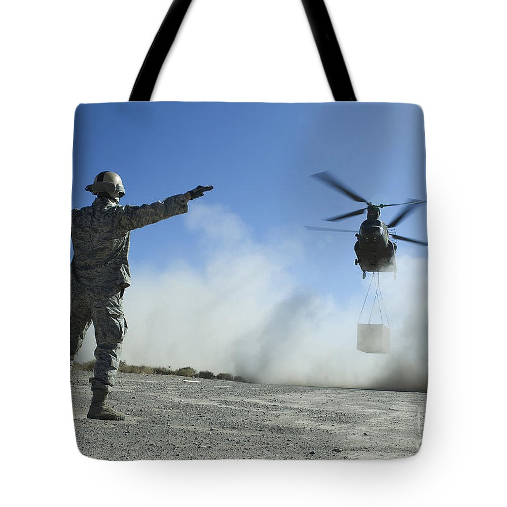 Military Tote Bag featuring the photograph U.s. Air Force Master Sergeant Guides by Stocktrek Images