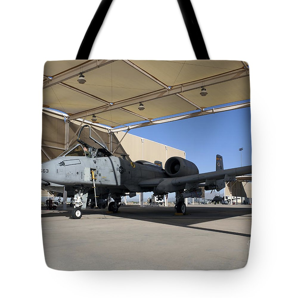Davis-monthan Air Force Base Tote Bag featuring the photograph U.s. Air Force Pilot Performs Final by Stocktrek Images