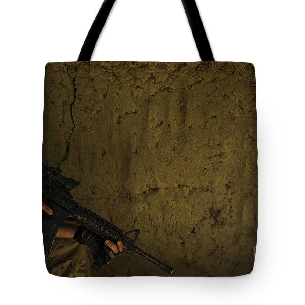 Air Force Tote Bag featuring the photograph U.s. Air Force Staff Sergeant Provides by Stocktrek Images