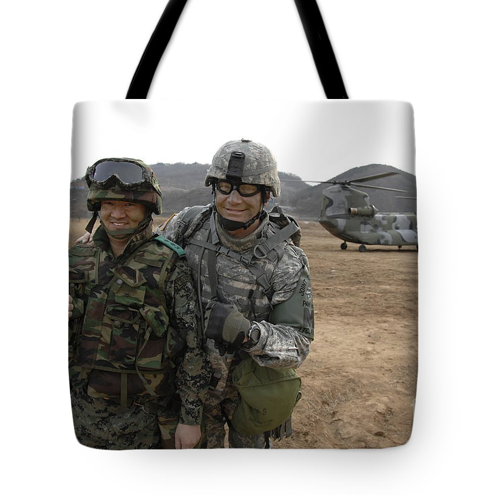Multinational Tote Bag featuring the photograph U.s. Army Commander, Right by Stocktrek Images