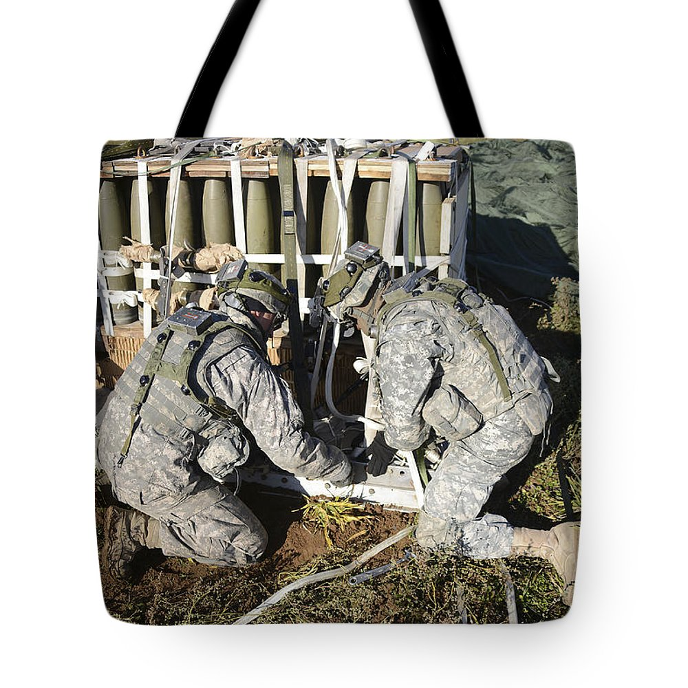 United States Army Europe Tote Bag featuring the photograph U.s. Army Europe Soldiers Perform by Stocktrek Images