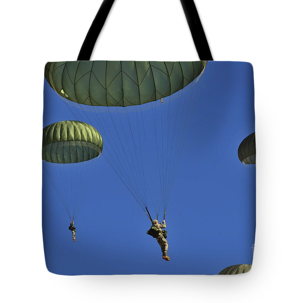 Us Air Force Tote Bag featuring the photograph U.s. Army Paratroopers Participate by Stocktrek Images