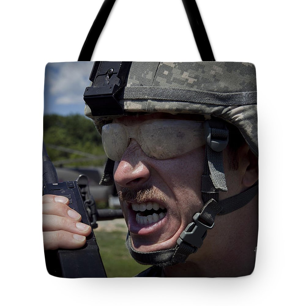 Fort Ap Hill Tote Bag featuring the photograph U.s. Army Sergeant Testing by Stocktrek Images