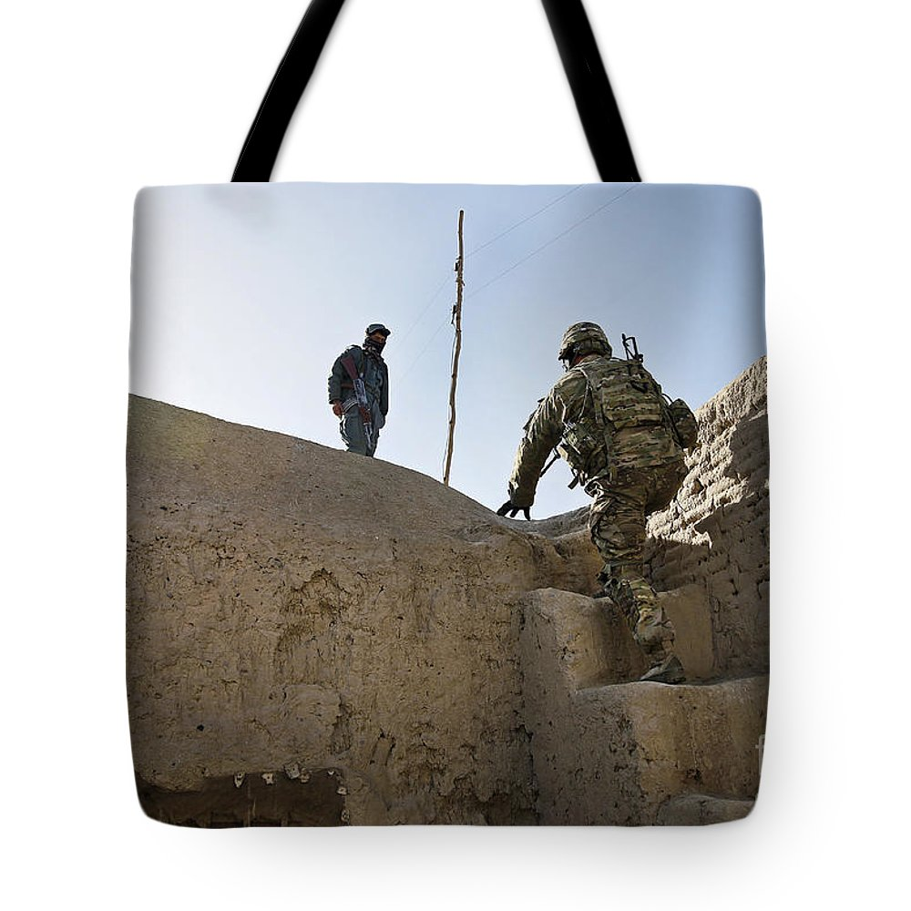 Afghanistan Tote Bag featuring the photograph U.s. Army Soldier Climbs Stairs by Stocktrek Images