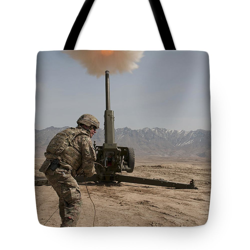 Middle East Tote Bag featuring the photograph U.s. Army Soldier Fires A 122mm by Stocktrek Images