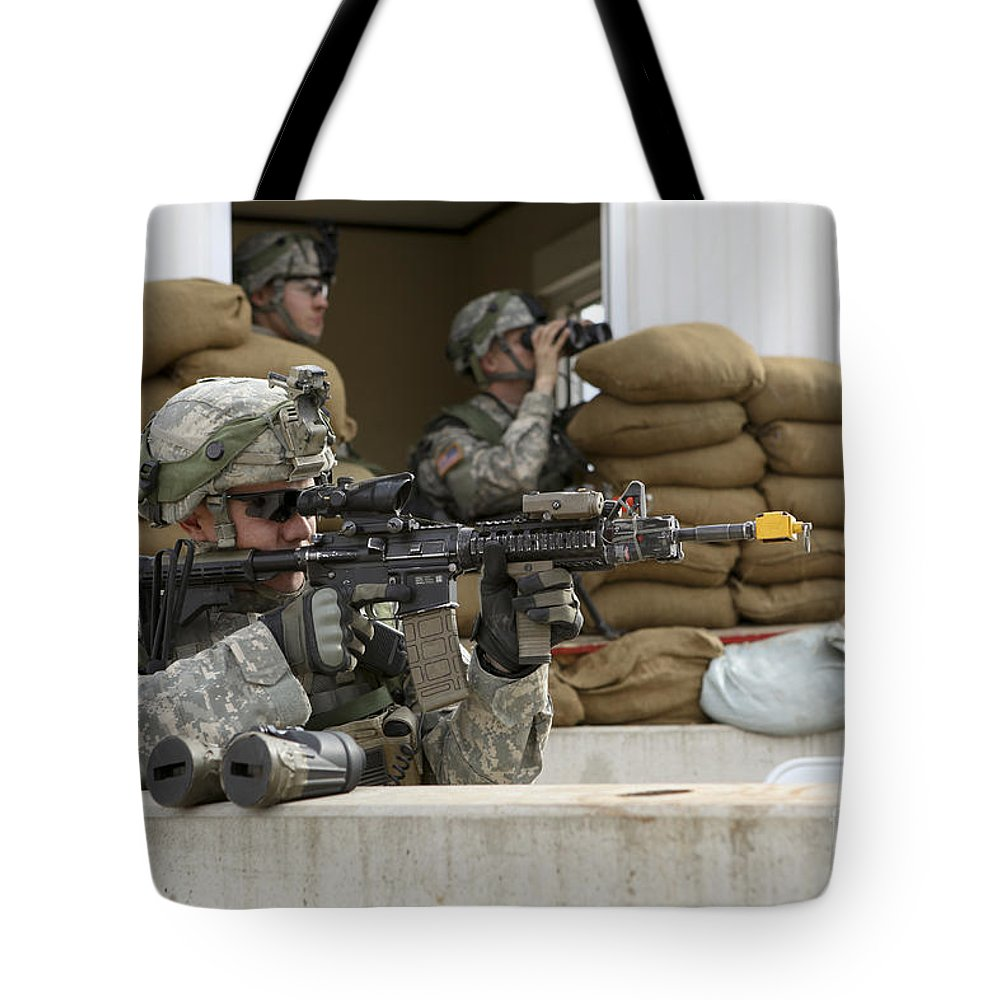 Germany Tote Bag featuring the photograph U.s. Army Soldier Looks Down The Scope by Stocktrek Images