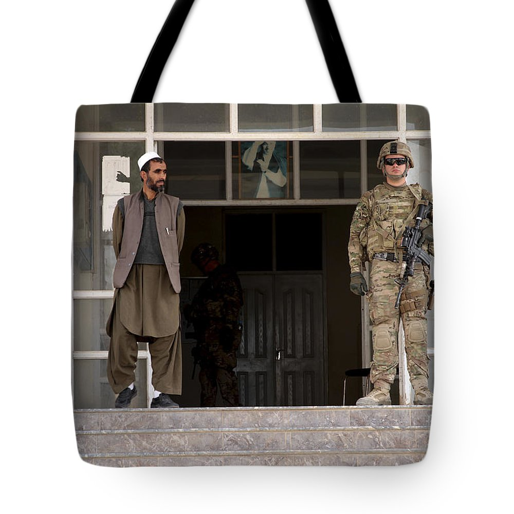Afghanistan Tote Bag featuring the photograph U.s. Army Soldier Stands Guard In Farah by Stocktrek Images