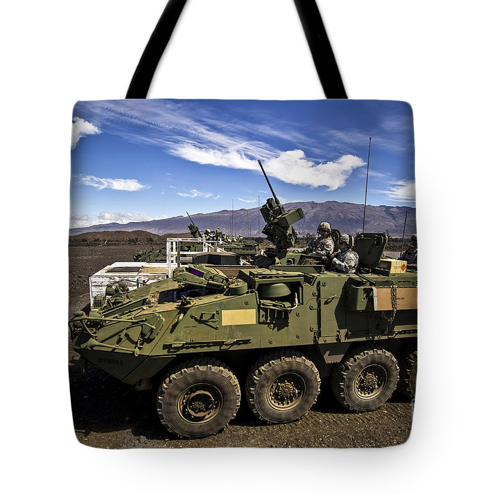 Pohakuloa Training Area Tote Bag featuring the photograph U.s. Army Soldiers Engage Targets by Stocktrek Images