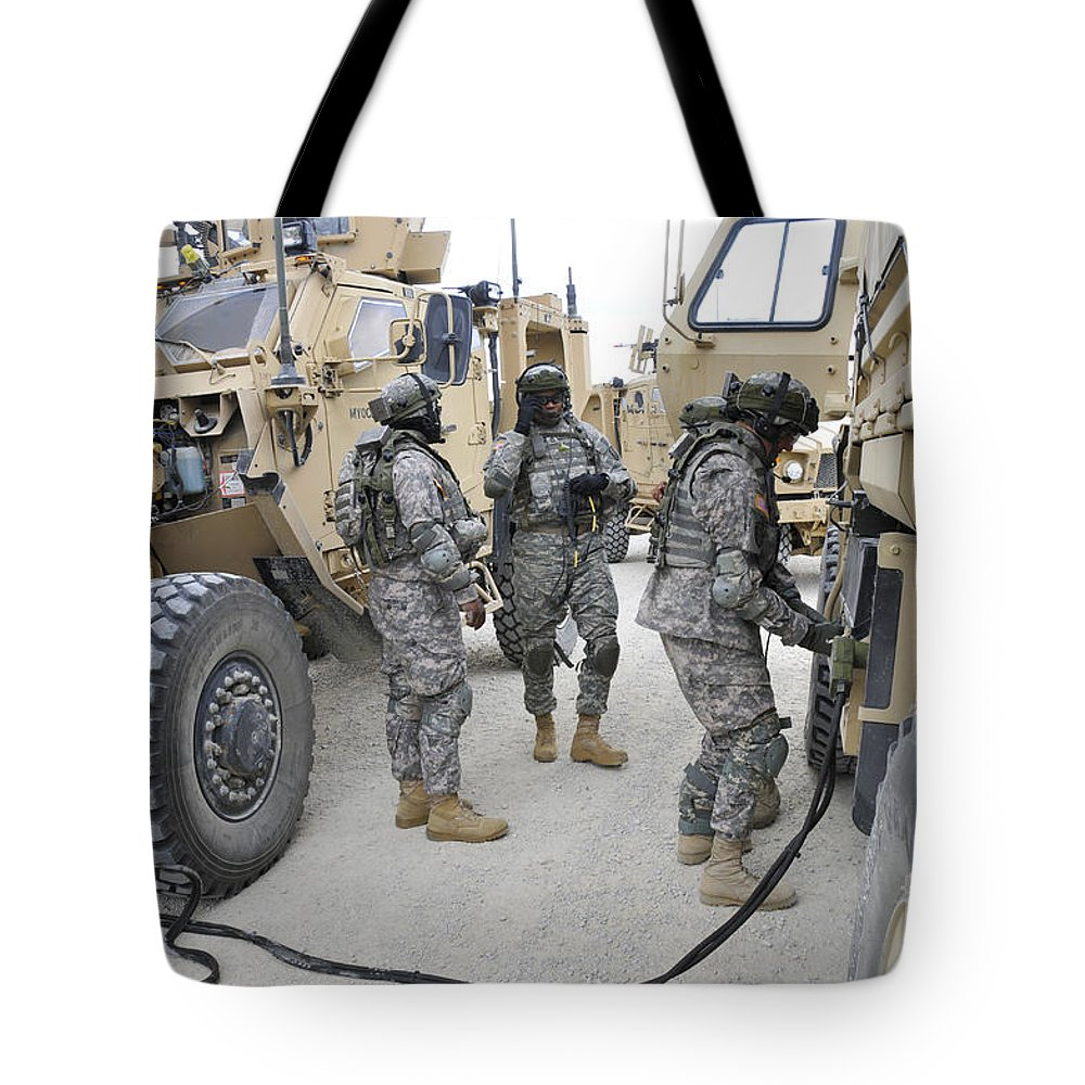 Germany Tote Bag featuring the photograph U.s. Army Soldiers Jump Start A Light by Stocktrek Images