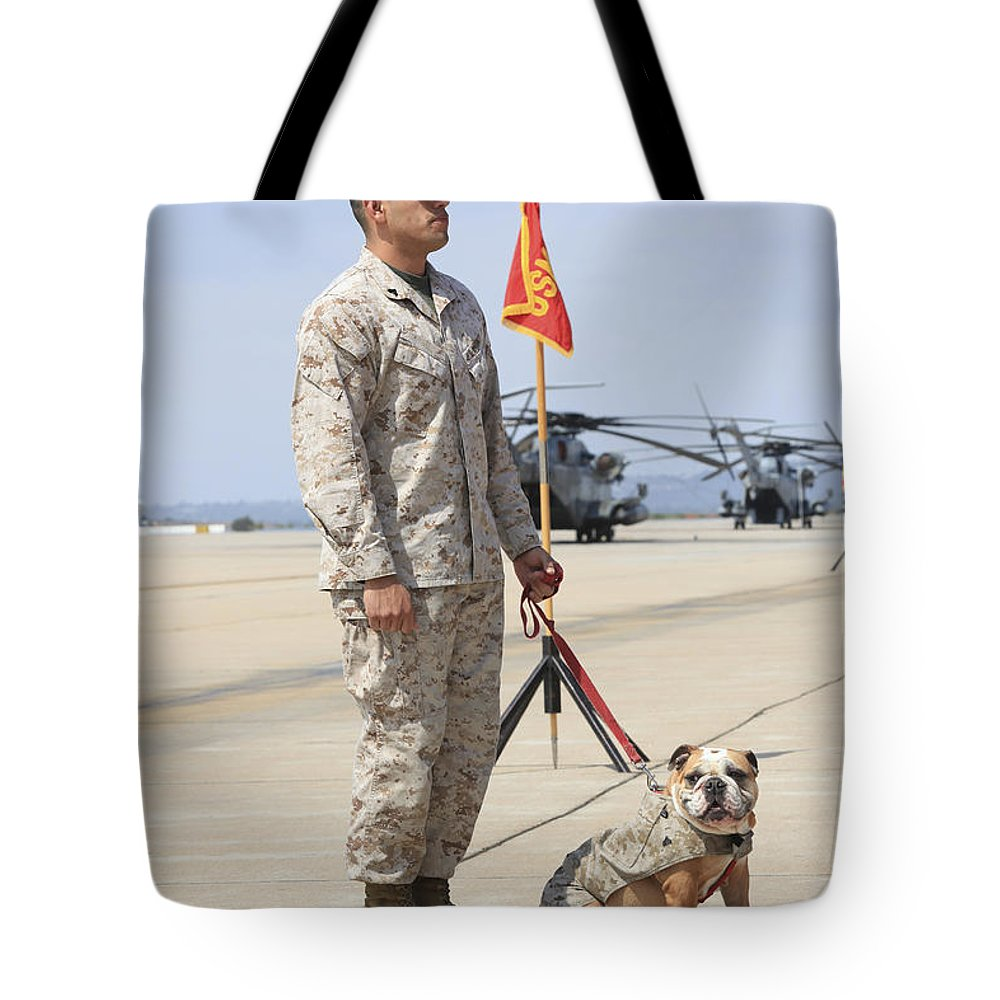 Platoon Tote Bag featuring the photograph U.s. Marine And The Official Mascot by Stocktrek Images