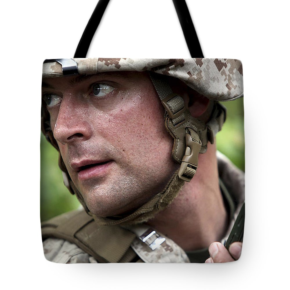 Military Tote Bag featuring the photograph U.s. Marine Calls For Helicopter by Stocktrek Images