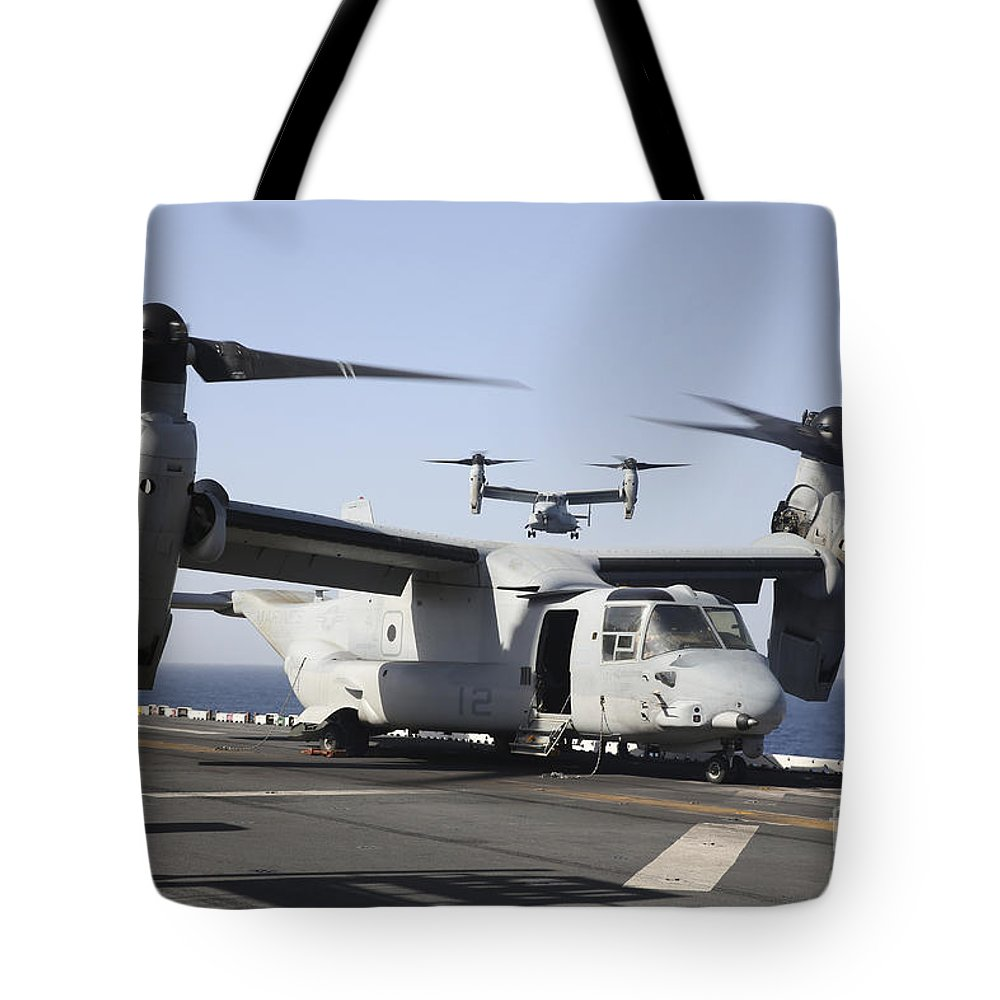 Us Navy Tote Bag featuring the photograph U.s. Marine Corps Mv-22b Osprey by Stocktrek Images