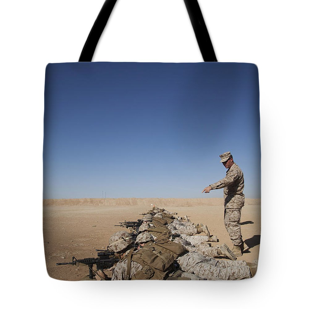 Middle East Tote Bag featuring the photograph U.s. Marine Corps Officer Directs by Stocktrek Images