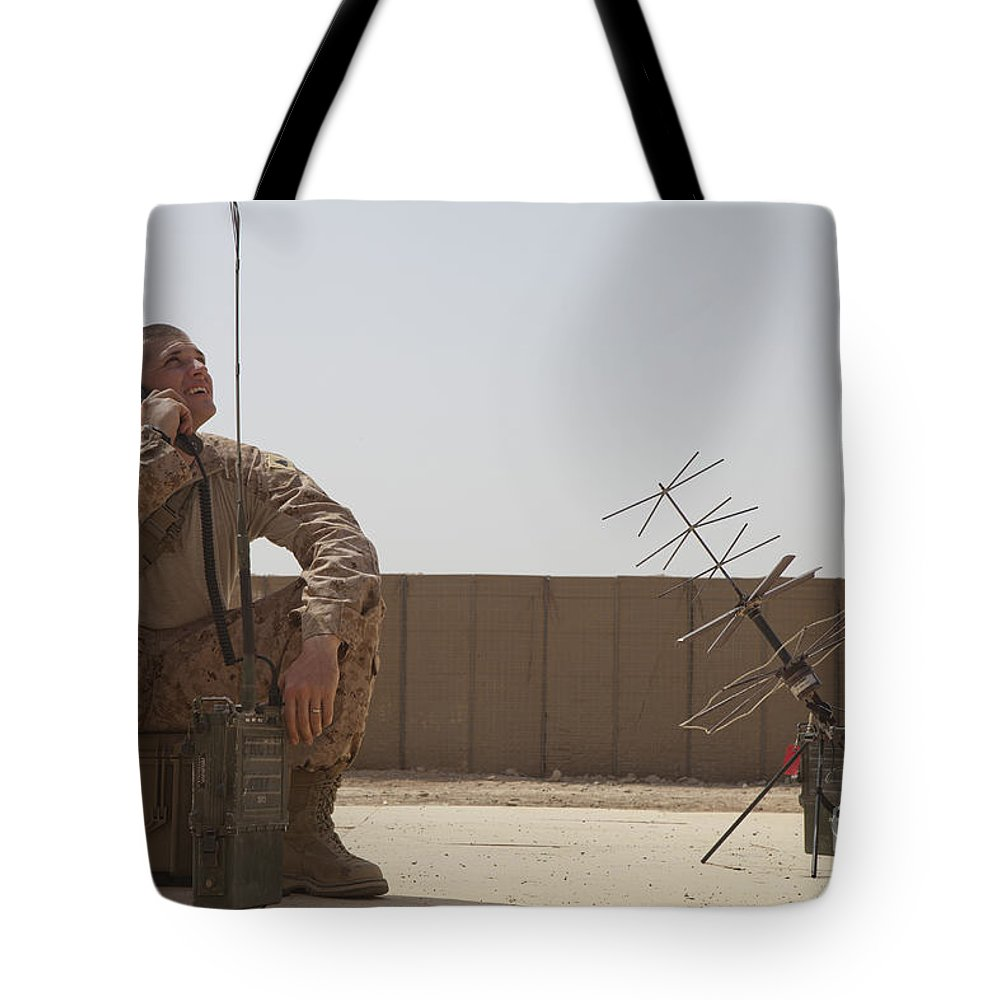 Us Marine Corps Tote Bag featuring the photograph U.s. Marine Looks Up To The Sky While by Stocktrek Images