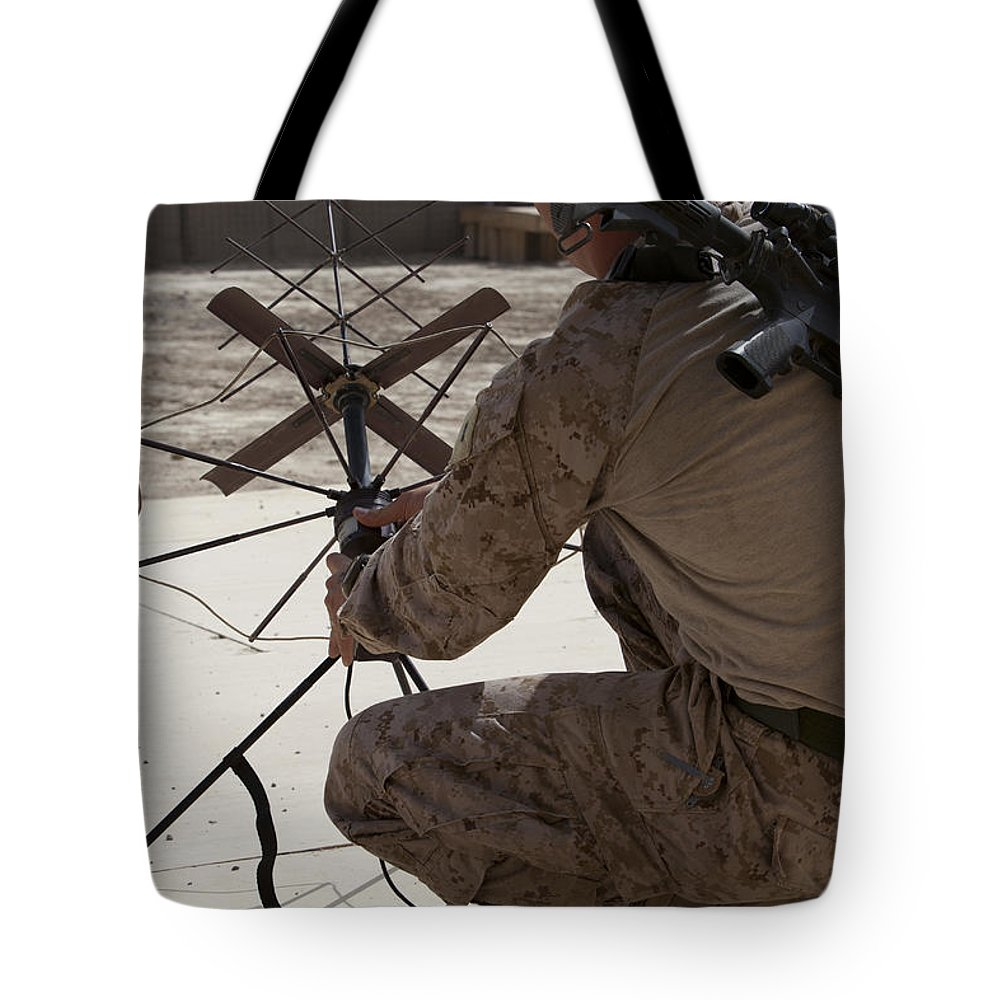 Communication Tote Bag featuring the photograph U.s. Marine Repositions A Satellite by Stocktrek Images