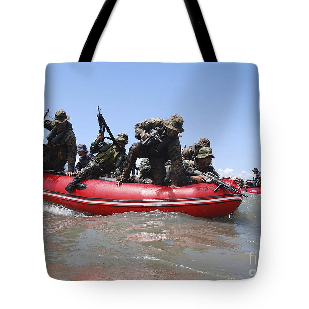 Military Tote Bag featuring the photograph U.s. Marines And Philippine Marines by Stocktrek Images