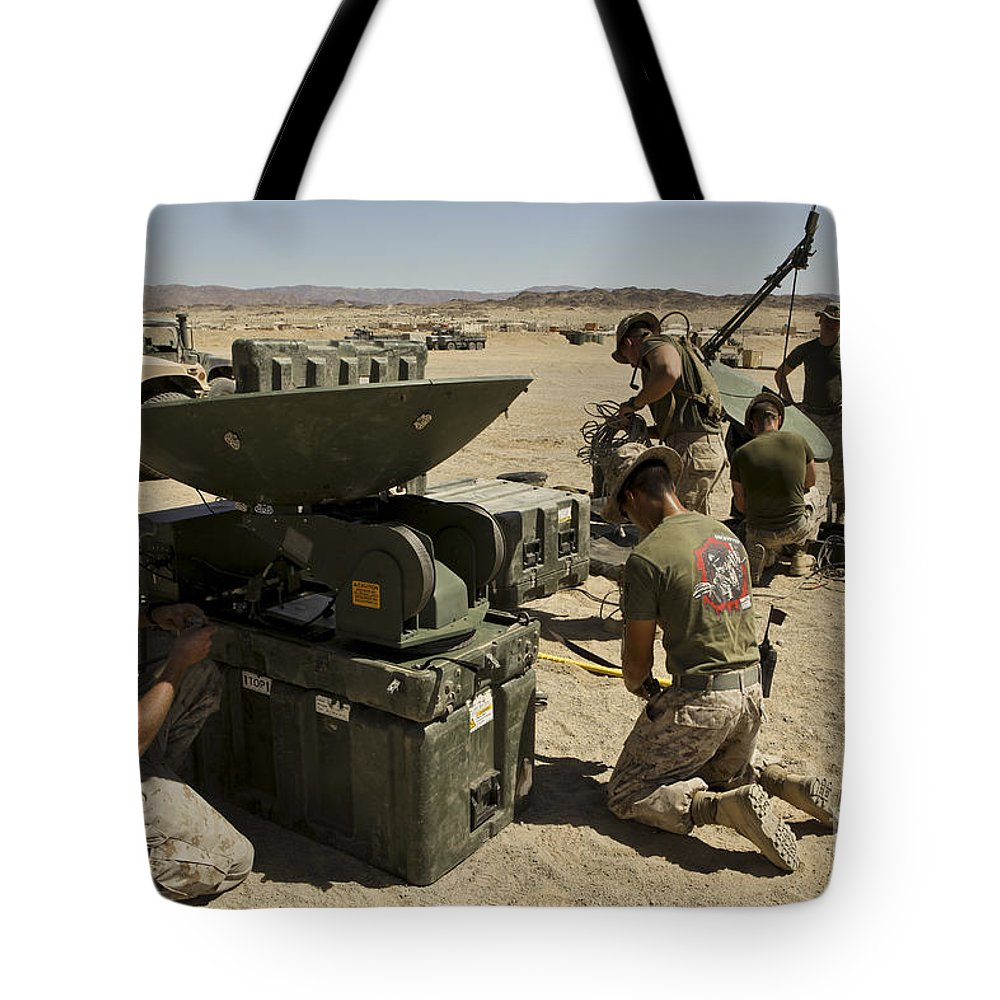 Military Tote Bag featuring the photograph U.s. Marines Assemble A Support Wide by Stocktrek Images