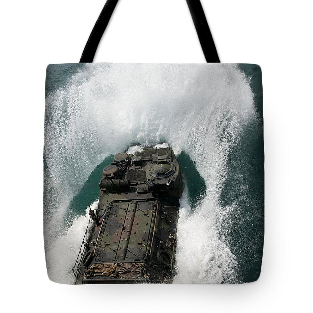 Military Tote Bag featuring the photograph U.s. Marines Drive An Assault by Stocktrek Images