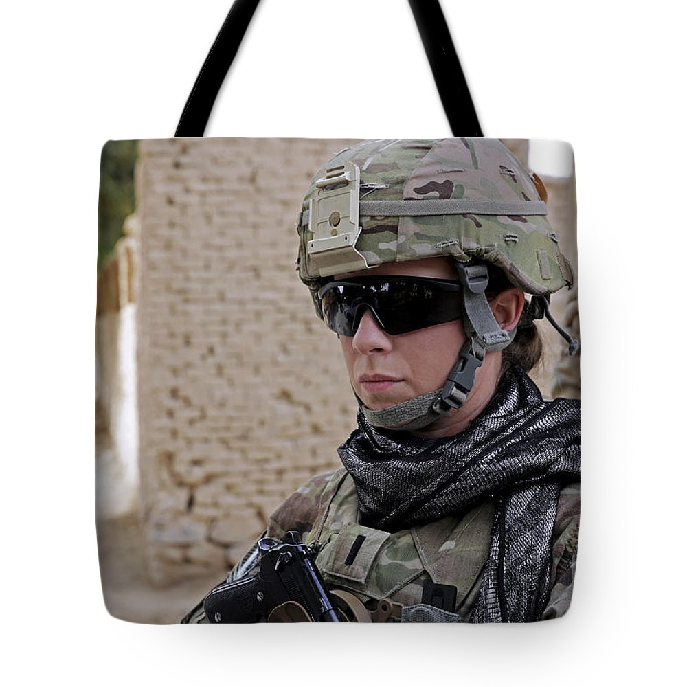 Operation Enduring Freedom Tote Bag featuring the photograph U.s. Navy Soldier At Farah City by Stocktrek Images