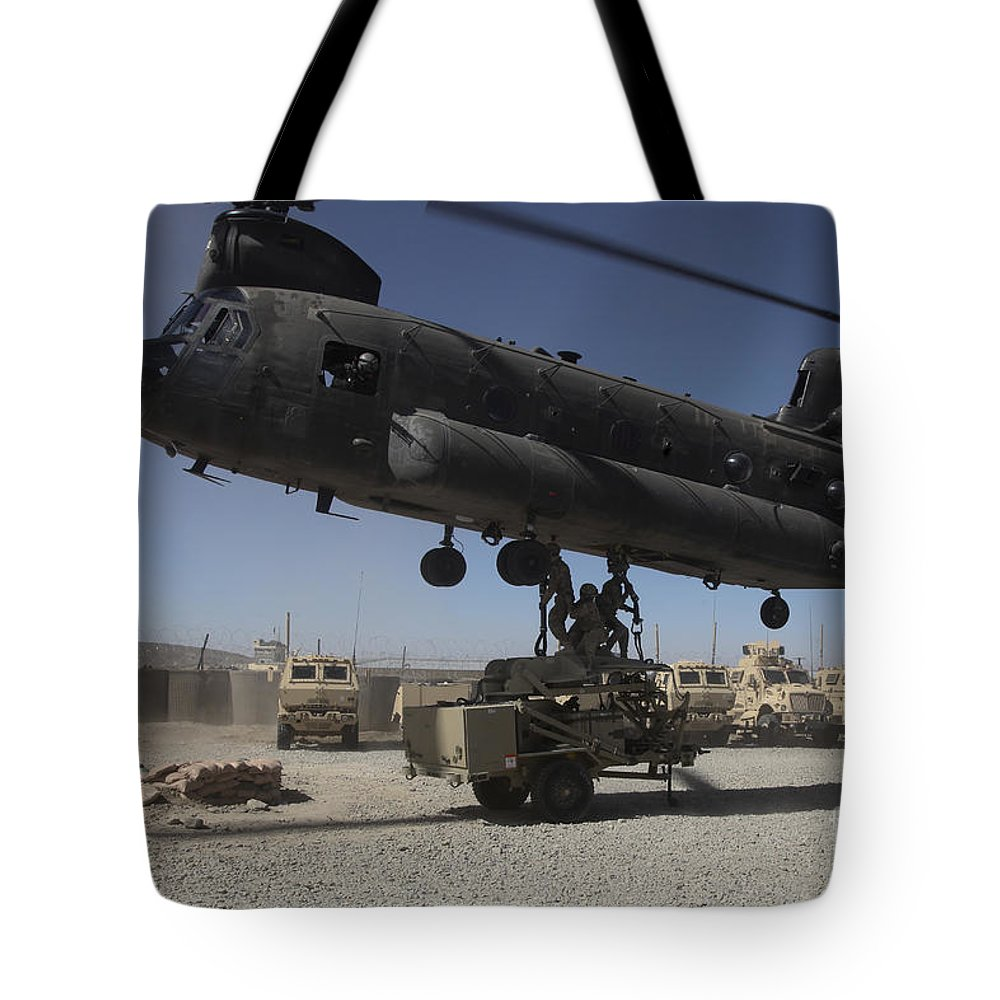 Middle East Tote Bag featuring the photograph U.s. Soldiers Attach Sling Load Ropes by Stocktrek Images