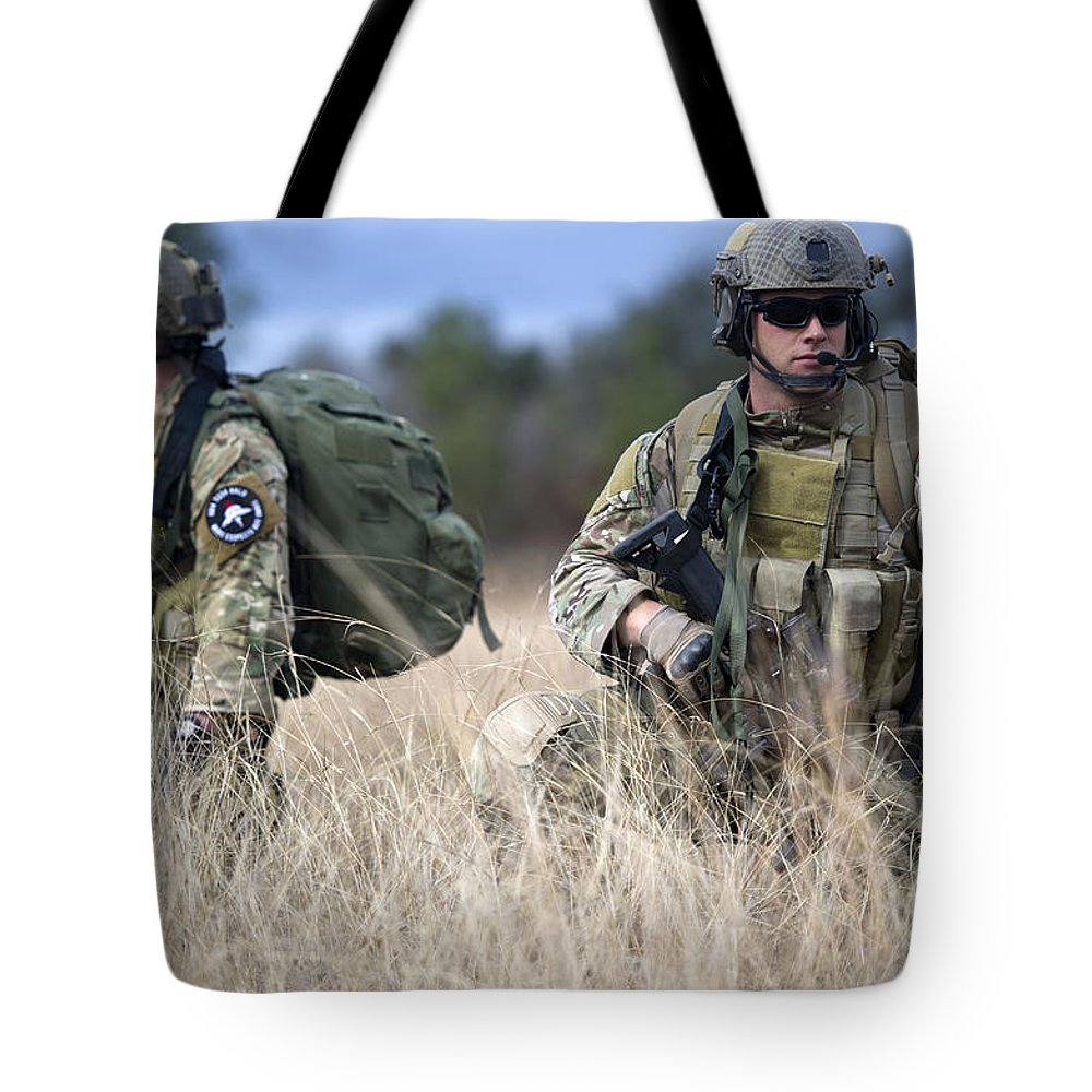 Special Forces Tote Bag featuring the photograph U.s. Soldiers Await The Arrival by Stocktrek Images
