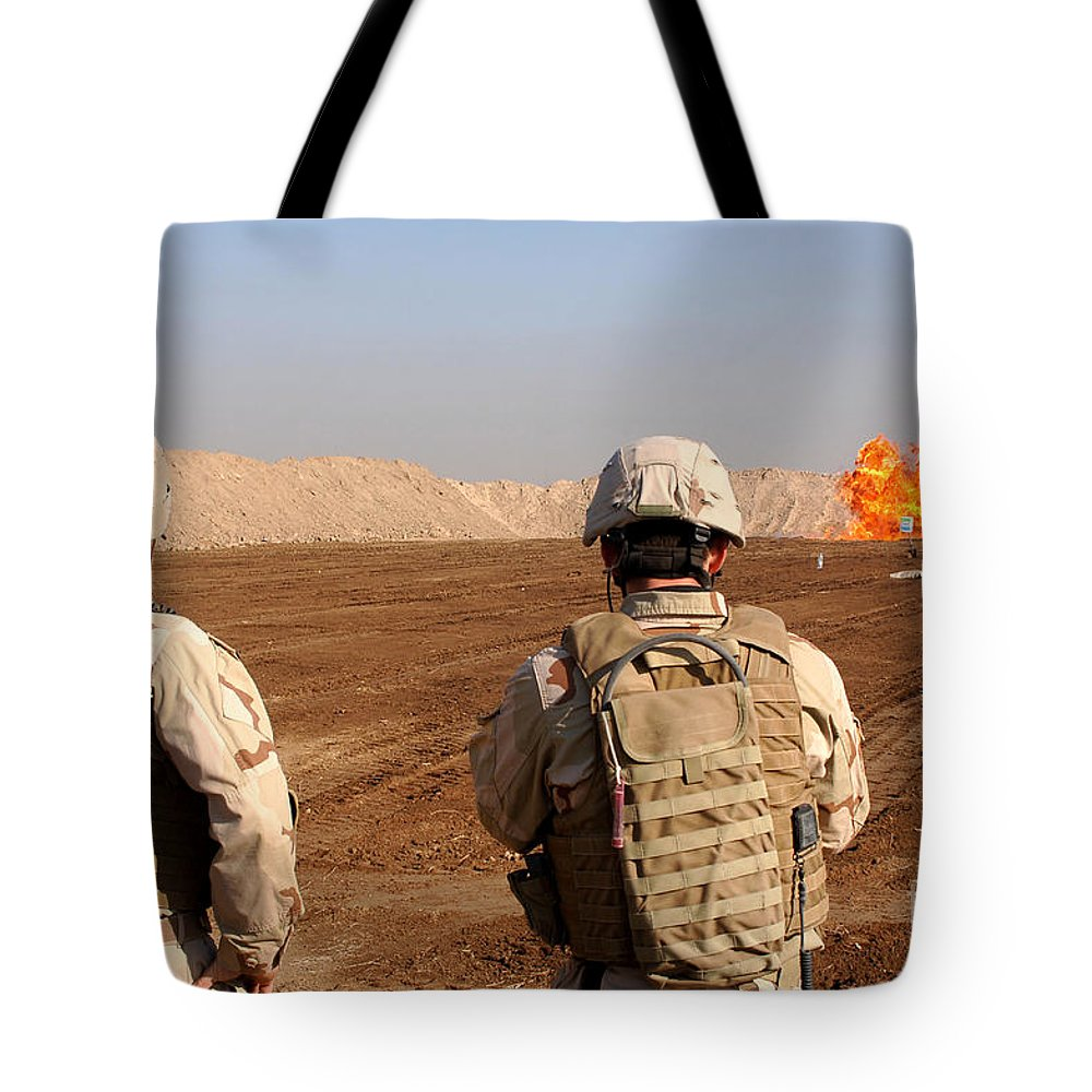 Military Tote Bag featuring the photograph U.s. Soldiers Detonate A Test Explosion by Stocktrek Images