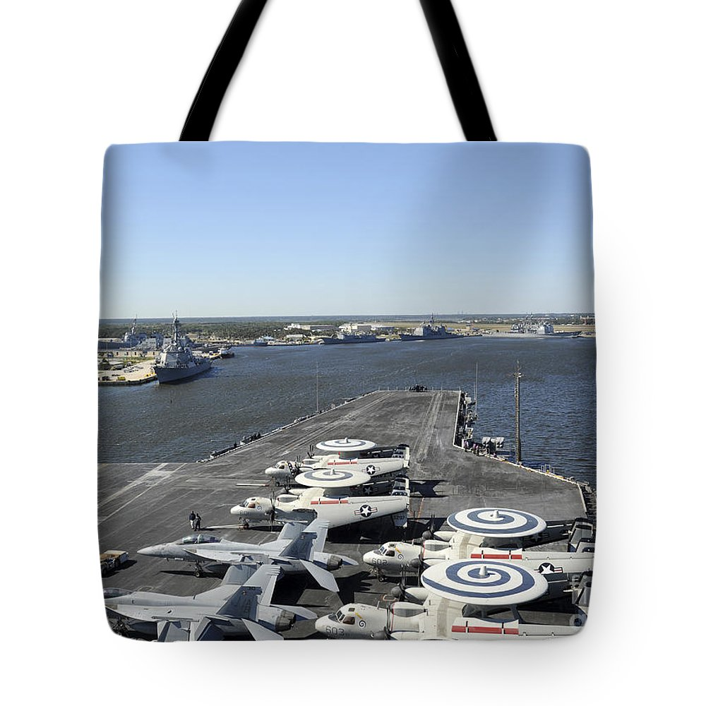 Military Tote Bag featuring the photograph Uss Enterprise Arrives At Naval Station by Stocktrek Images