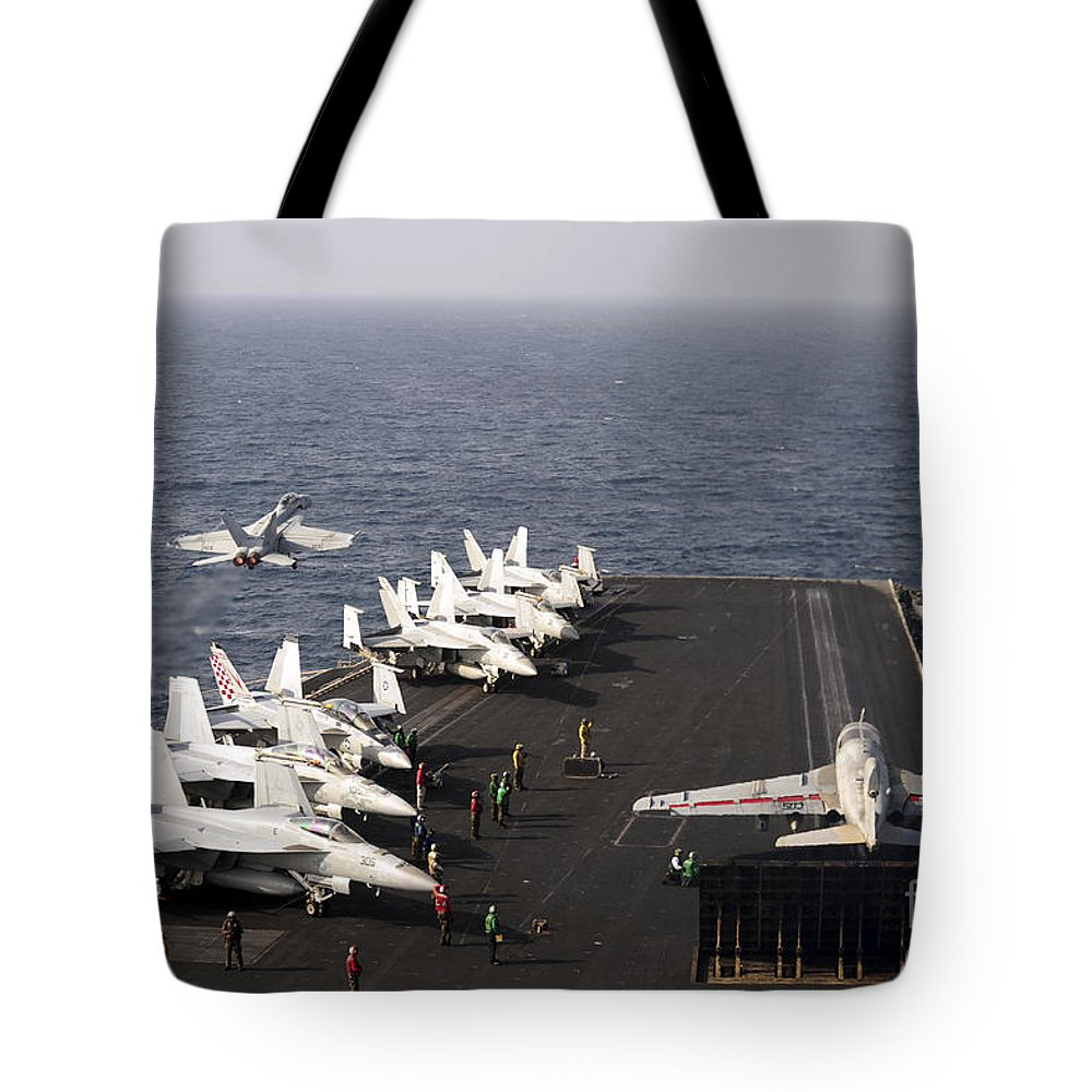 Military Tote Bag featuring the photograph Uss Enterprise Conducts Flight by Stocktrek Images