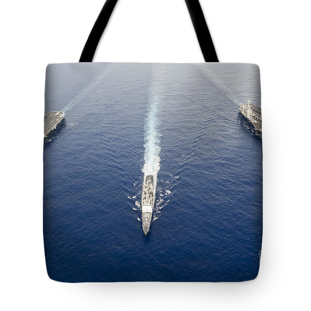 Uss George Washington Tote Bag featuring the photograph Uss George Washington, Uss Mobile Bay by Stocktrek Images