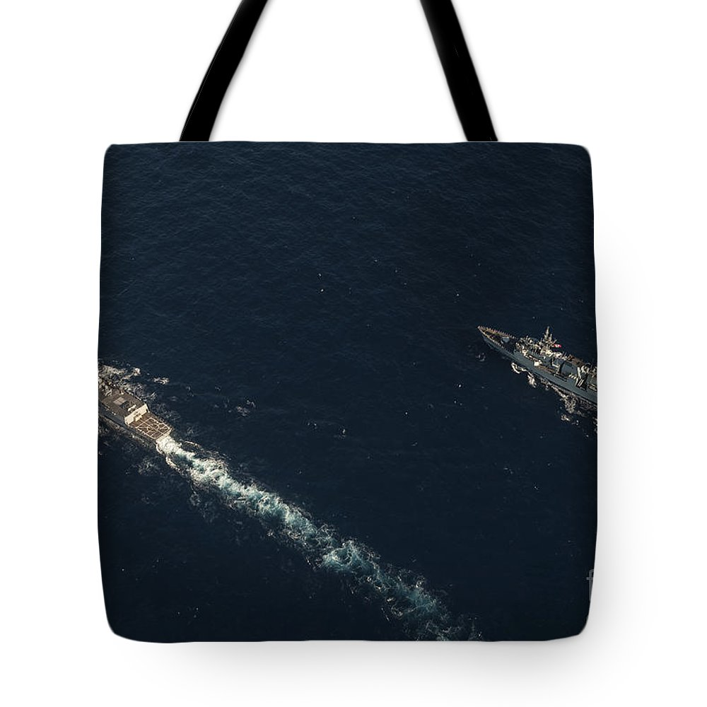 Military Tote Bag featuring the photograph Uss Stockdale And The Canadian Frigate by Stocktrek Images
