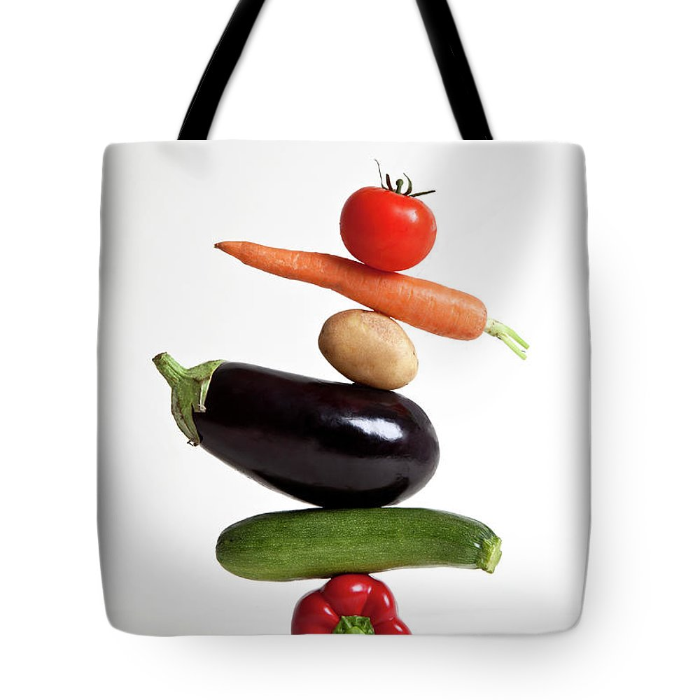 Shadow Tote Bag featuring the photograph Vegetables Arranged In A Stack by Halfdark