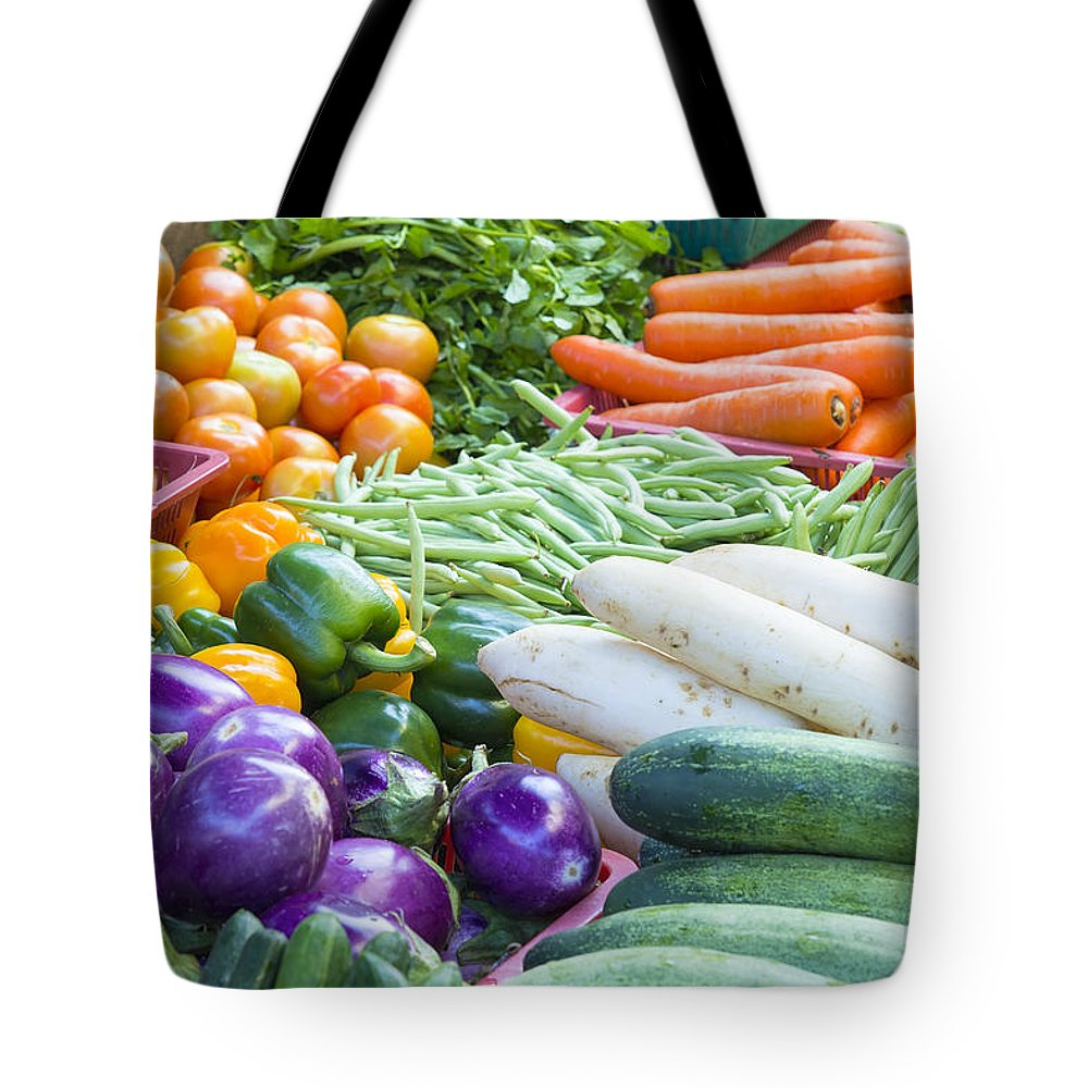 Vegetable Tote Bag featuring the photograph Vegetables Stand In Wet Market by Jit Lim