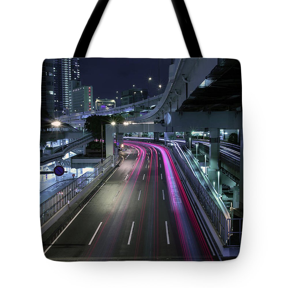 Yokohama Tote Bag featuring the photograph Vehicle Light Trails On National Route 1 by Digipub