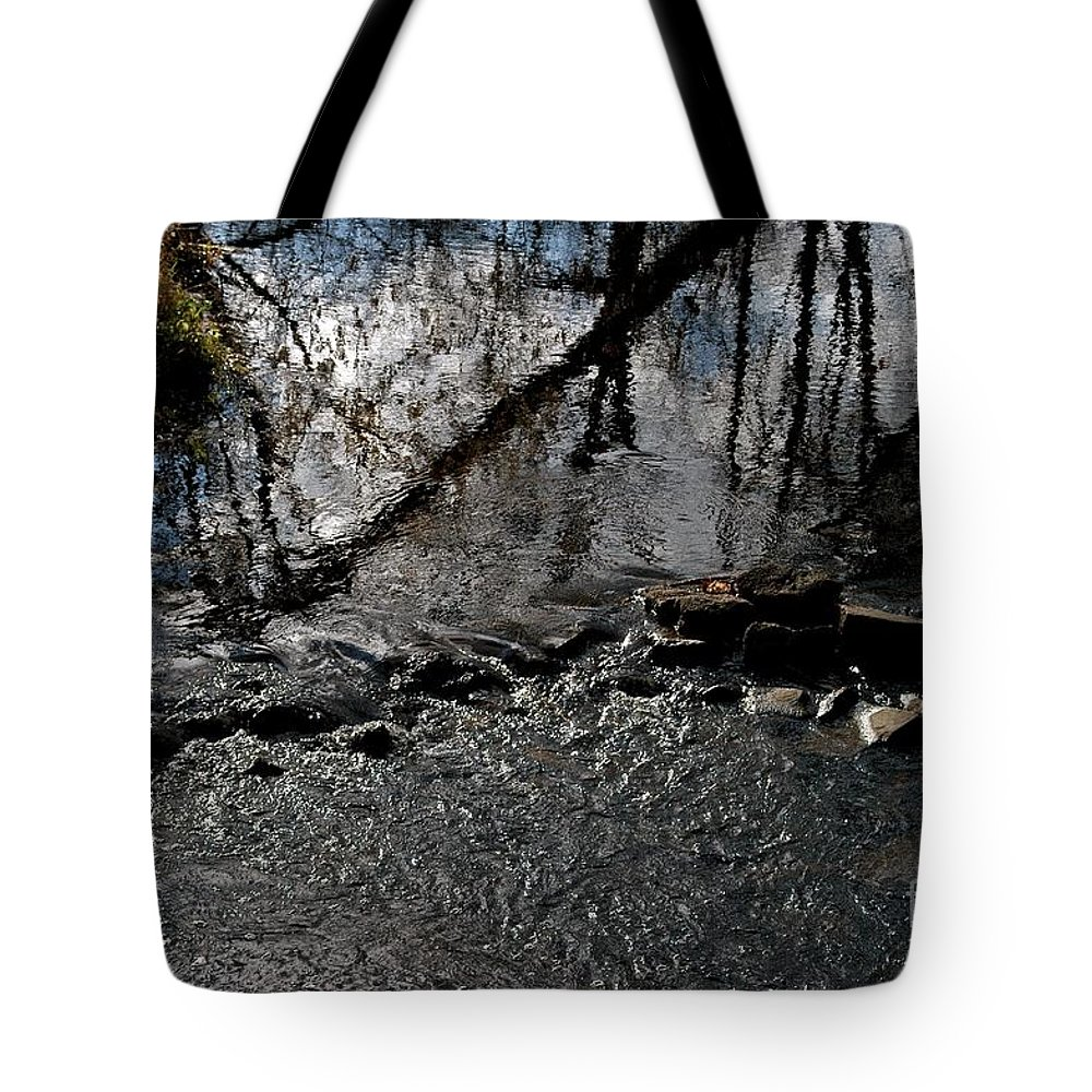 Reflections Tote Bag featuring the photograph Vermillion Refractions by Joseph Yarbrough