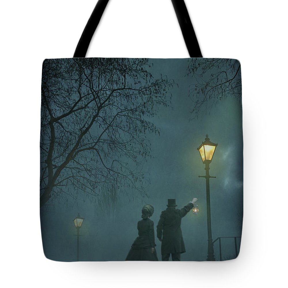 Victorian Tote Bag featuring the photograph Victorian Couple At Night by Lee Avison