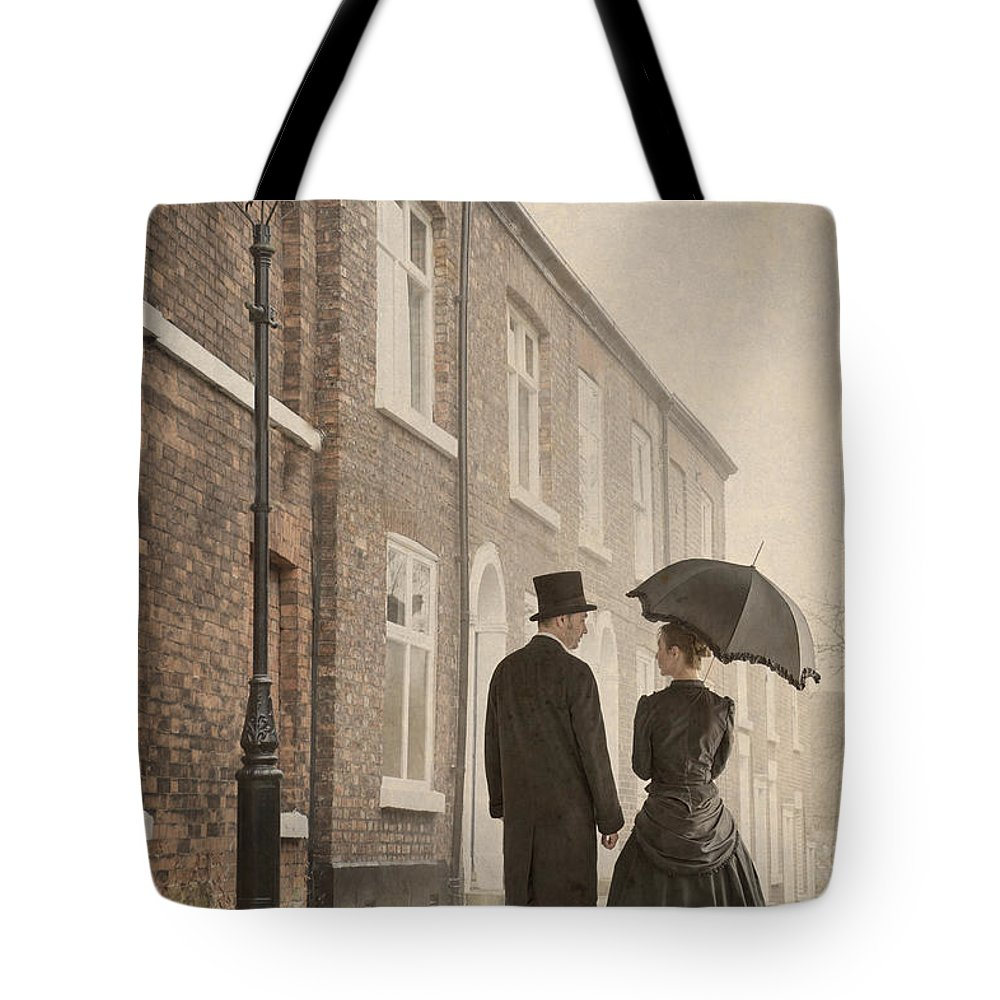 Victorian Tote Bag featuring the photograph Victorian Couple On A Cobbled Street by Lee Avison