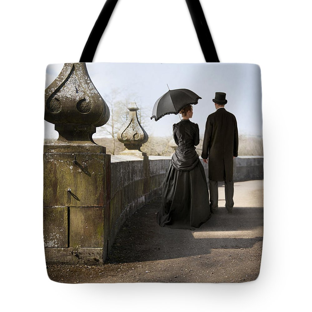 Victorian Tote Bag featuring the photograph Victorian Couple Walking In The Grounds by Lee Avison
