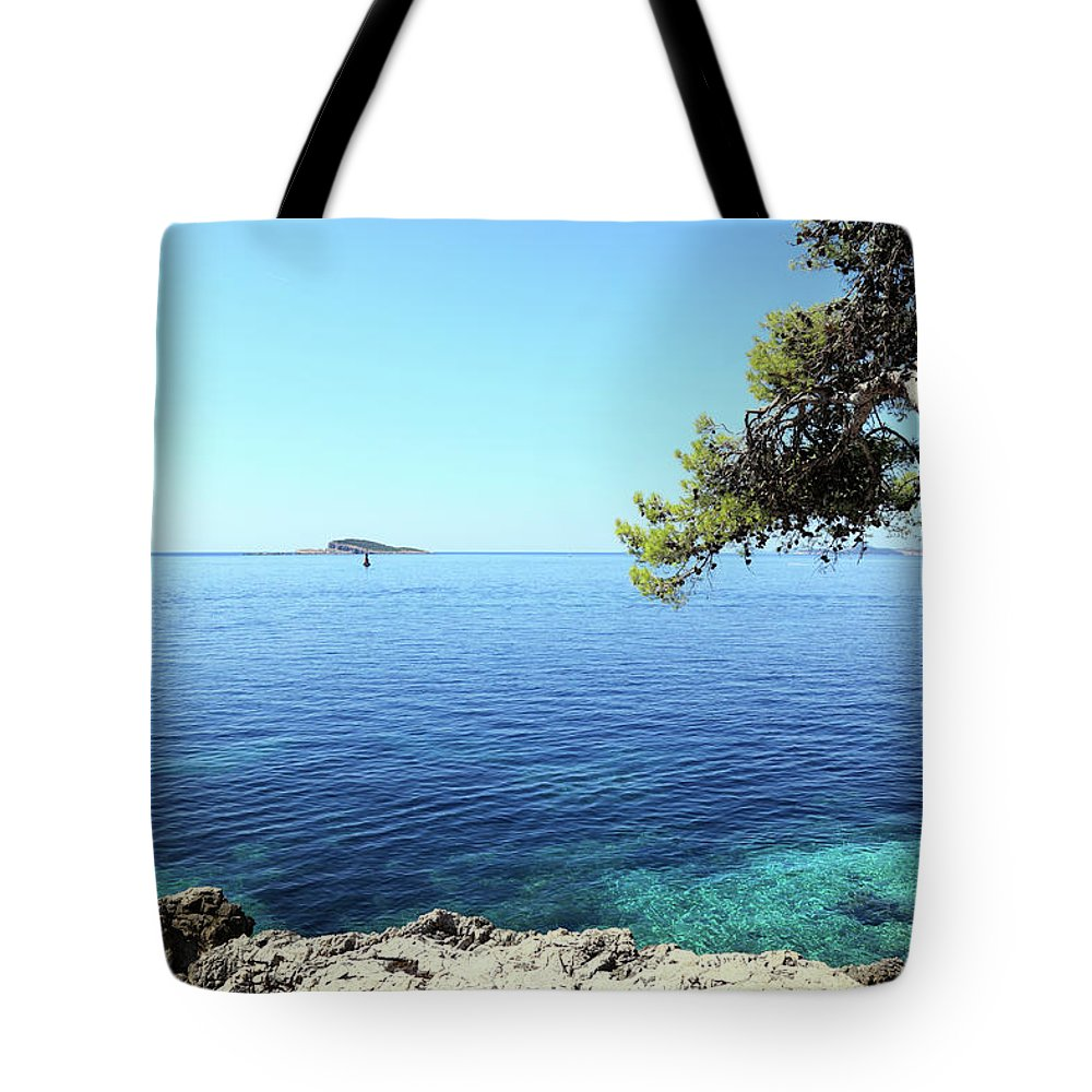 Water's Edge Tote Bag featuring the photograph View Of Dubrovnik From Cavtat Peninsula by Vuk8691