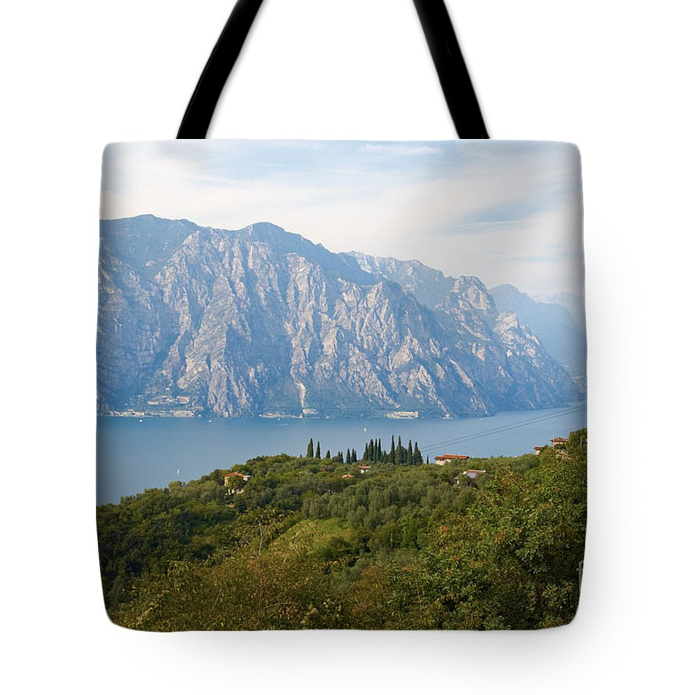 Lake Tote Bag featuring the photograph View Over The Lake Garda In Italy by Nick Biemans