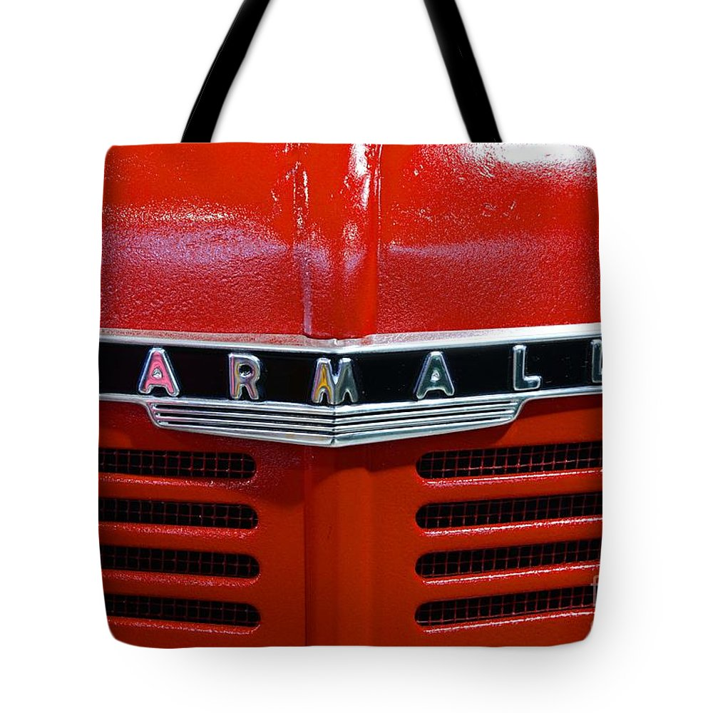 Paul Ward Tote Bag featuring the photograph Vintage 1947 Farmall Tractor by Paul Ward