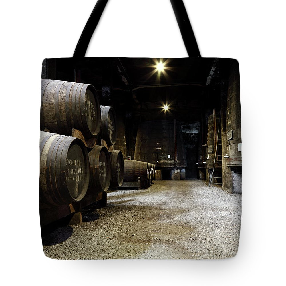 Desaturated Tote Bag featuring the photograph Vintage Porto Wine Cellar by Vuk8691