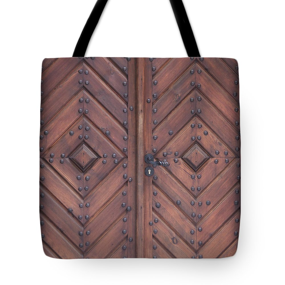 Material Tote Bag featuring the photograph Vintage Wooden Brown Door Close-up by Bogdan Khmelnytskyi