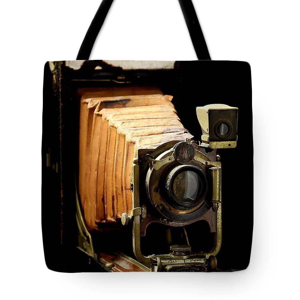 Vintaged Canadian Kodak Camera Tote Bag featuring the photograph Vintaged Canadian Kodak Camera by Athena Mckinzie