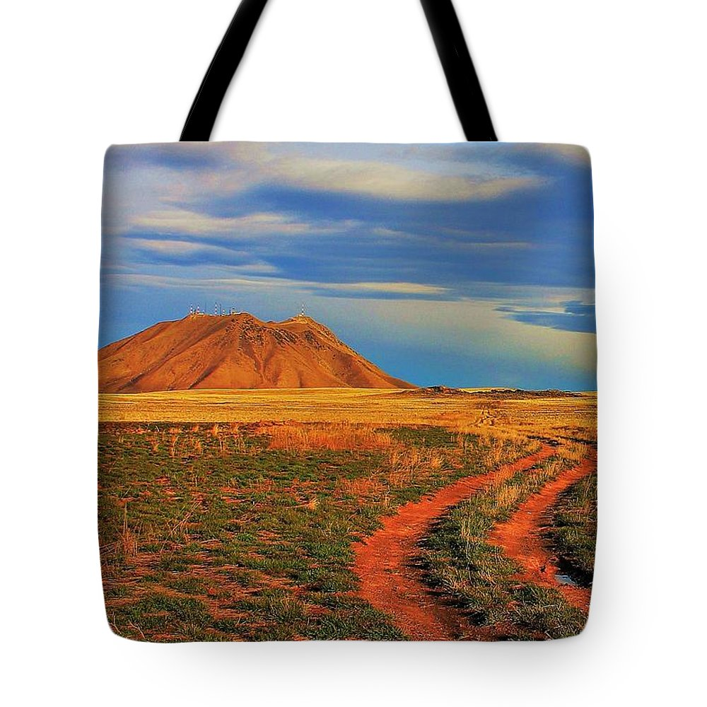 Idaho Tote Bag featuring the photograph Volcano Road by Benjamin Yeager