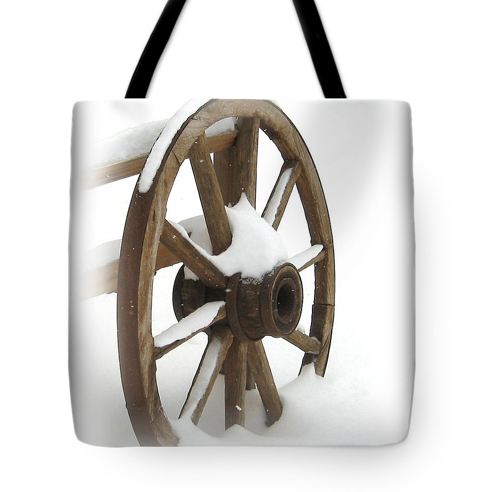 Wagon Tote Bag featuring the photograph Wagon Wheel In Snow by Lynn Sprowl