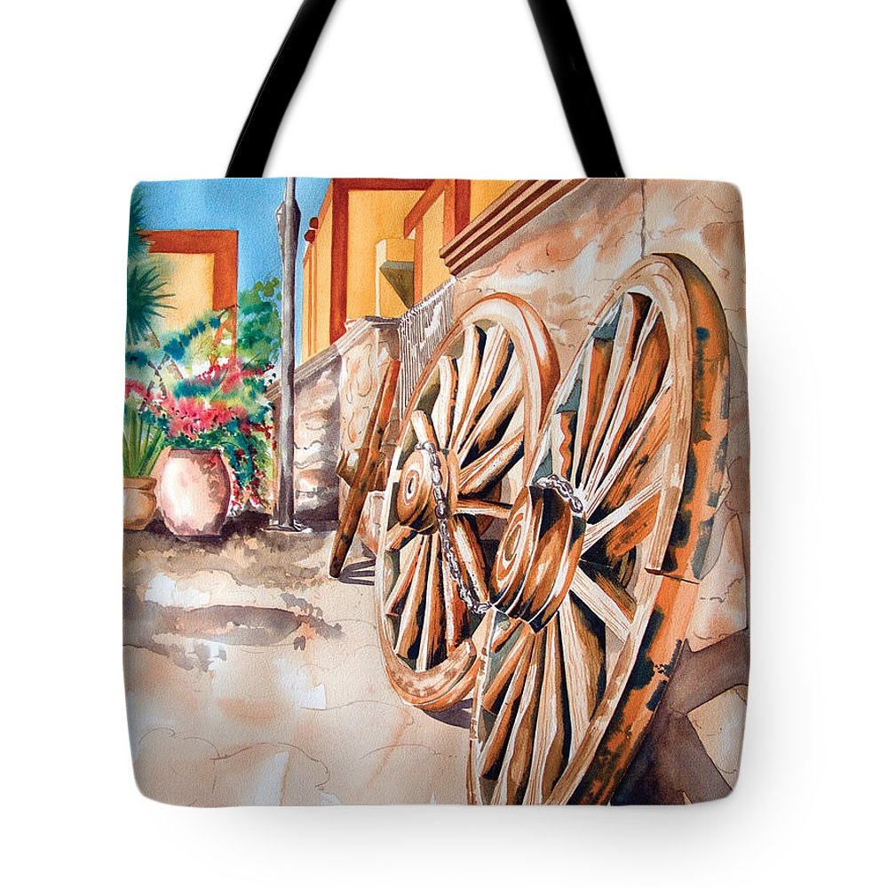 Landscape Paintings Tote Bag featuring the painting Wagon Wheels by Kandyce Waltensperger
