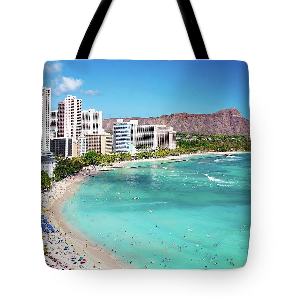 Water's Edge Tote Bag featuring the photograph Waikiki Beach by M Swiet Productions
