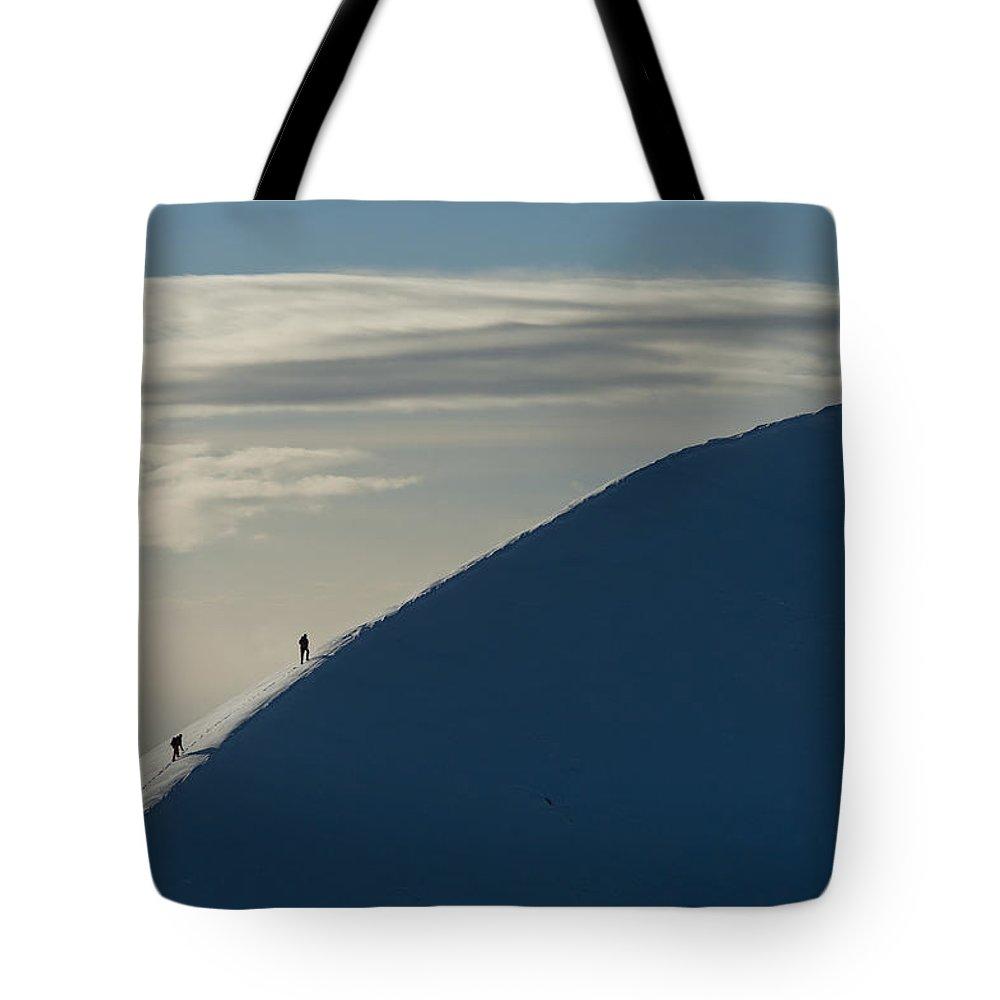 Cumming Tote Bag featuring the photograph Walkers Climbing Snowy Ridge Of Sgorr by Ian Cumming