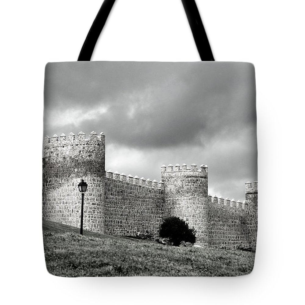 Cathedral Tote Bag featuring the photograph Wall Against Clouds by Lorraine Devon Wilke